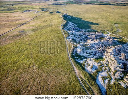 prairie ranch roads and limestone outcroppings near Castle Rock  in Kansas (Gove County), aerial view
