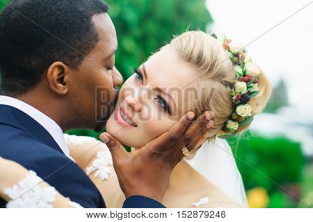 Groom Kisses Face Of Bride