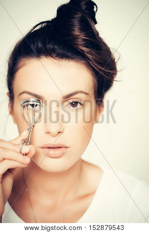 Pretty Girl Curling Eyelashes With Tongs