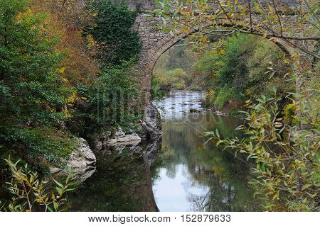 The Yantra river and old stone bridge in the fall