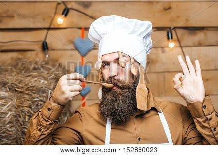 Chef Cook With Wooden Spoons