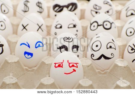 Painted eggs in tray smiles winks Poirot