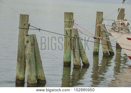 Boat mooring in a row by the sea, secured
