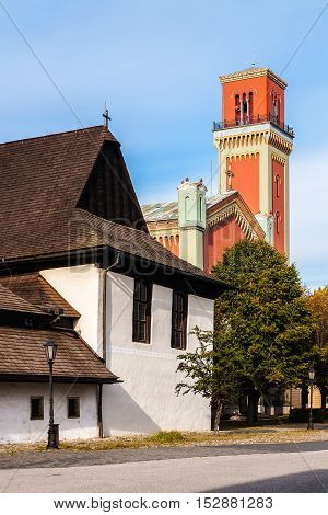 Wooden articular church built in 1717 and New red protestant church built in 1894 in Kezmarok Spis region Slovakia. Old one is registered in UNESCO List of the World Cultural Heritage