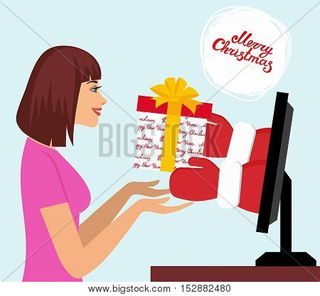 Internet Marketing concept. Beautiful woman pick up a present of Santa Claus hands from computer monitor