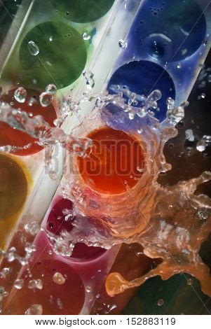 photo of paints being splashed with water
