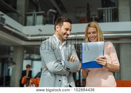 Two business people discussing about work in an office.
