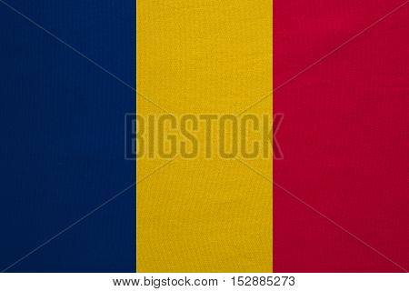 Chadian national official flag. African patriotic symbol banner element background. Correct colors. Flag of Chad with real detailed fabric texture accurate size illustration