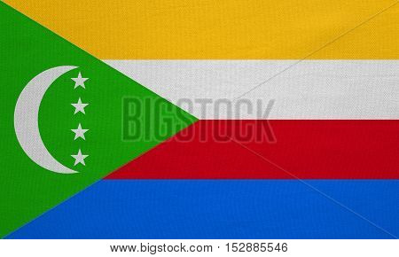 Comorian national official flag. African patriotic symbol banner element background. Correct colors. Flag of Comoros with real detailed fabric texture accurate size illustration
