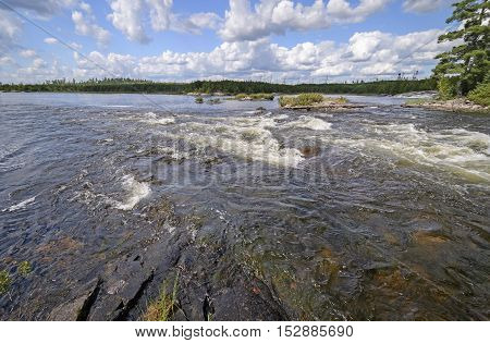Raging Rapids in the Wilderness of the Falls Chain in Quetico Provincial Park in Ontario