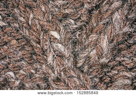 Macro flat view of rough wool knitted surface