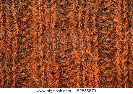 Macro flat view of knitted surface in copper ribs