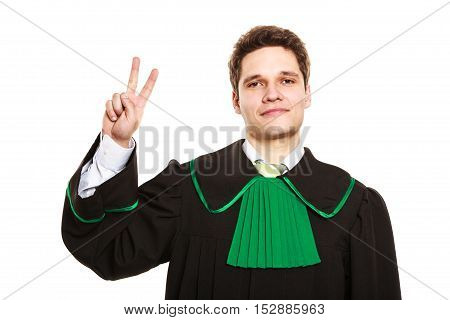 Understanding and explaining sending clear message. Young lawyer wear polish toga and show hand sign. Man make gesture with hand two fingers victory sign.