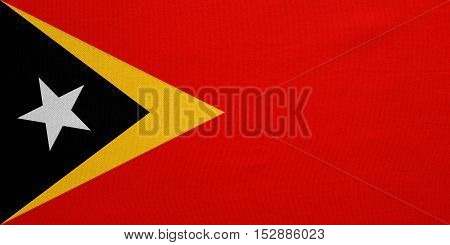 East Timorese national official flag. Patriotic symbol banner element background. Correct colors. Flag of East Timor with real detailed fabric texture accurate size illustration