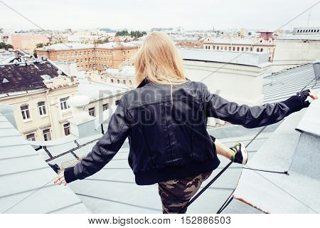 young pretty fashion lady on roof top having fun party time, lifestyle people conceptyoung pretty fashion lady on roof top having fun party time, lifestyle people concept close up