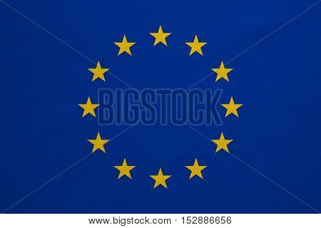 European Union official flag. Patriotic EU symbol. banner element design background. Correct colors. Flag of Europe with real detailed fabric texture accurate size illustration