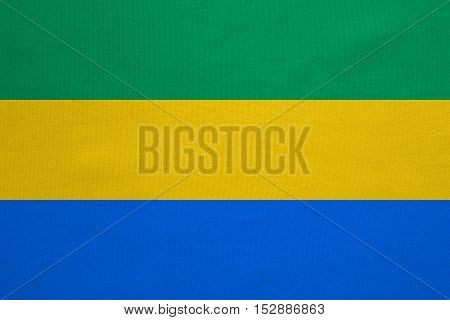 Gabonese national official flag. African patriotic symbol banner element background. Correct colors. Flag of Gabon with real detailed fabric texture accurate size illustration