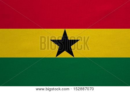 Ghanaian national official flag. African patriotic symbol banner element background. Correct colors. Flag of Ghana with real detailed fabric texture accurate size illustration