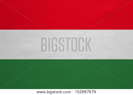 Hungarian national official flag. Patriotic symbol banner element background. Correct colors. Flag of Hungary with real detailed fabric texture accurate size illustration