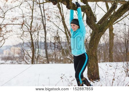 Young Lady Doing Workout In Park.