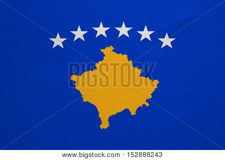 Kosovan national official flag. Patriotic symbol banner element background. Correct colors. Flag of Kosovo with real detailed fabric texture accurate size illustration