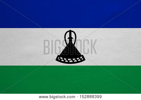Lesotho national official flag. Basotho african patriotic symbol banner element background. Correct colors. Flag of Lesotho with real detailed fabric texture accurate size illustration