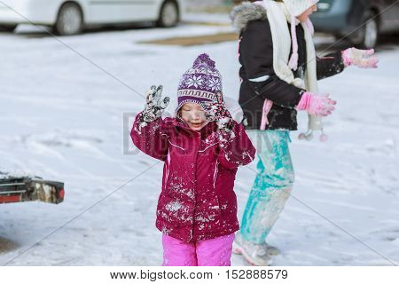 little girl playing with snow in winter kids winter activities