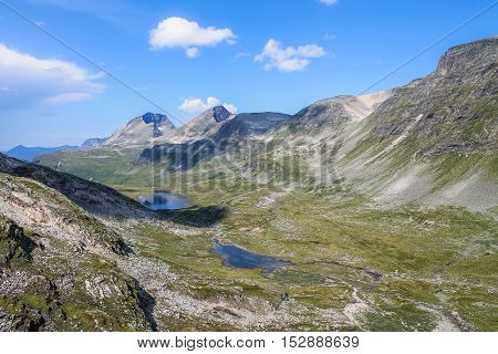 Mountain Valley in the Norwegian Highlands on a Sunny Summer Day with Blue Sky