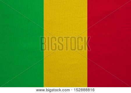 Malian national official flag. African patriotic symbol banner element background. Correct colors. Flag of Mali with real detailed fabric texture accurate size illustration