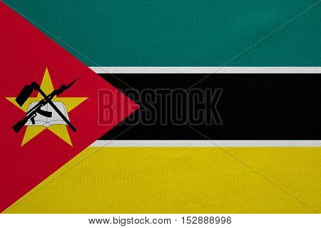 Mozambican national official flag. African patriotic symbol banner element background. Correct colors. Flag of Mozambique with real detailed fabric texture accurate size illustration