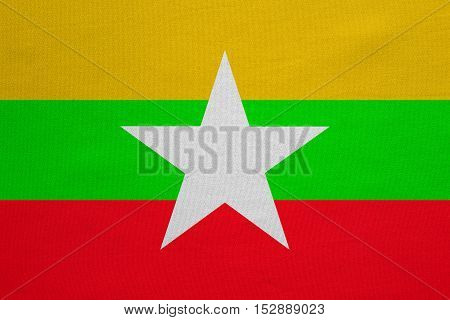 Myanmar national official flag. Patriotic symbol banner element background. Correct colors. Flag of Myanmar with real detailed fabric texture accurate size illustration