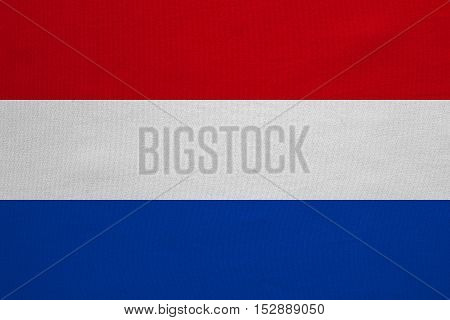 Netherlands national official flag. Patriotic symbol banner element background. Correct colors. Flag of the Netherlands with real detailed fabric texture accurate size illustration