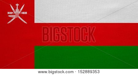 Omani national official flag. Patriotic symbol banner element background. Correct colors. Flag of Oman with real detailed fabric texture accurate size illustration