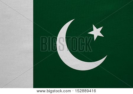 Pakistani national official flag. Patriotic symbol banner element background. Correct colors. Flag of Pakistan with real detailed fabric texture accurate size illustration