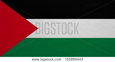 Palestinian national official flag. Patriotic symbol banner element background. Correct colors. Flag of Palestine with real detailed fabric texture accurate size illustration
