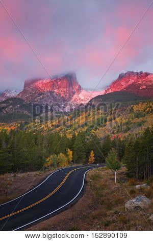 Sunrise on Bear Lake Road in Rocky Mountain National Park as Hallett Peak lights up with the Alpine glow
