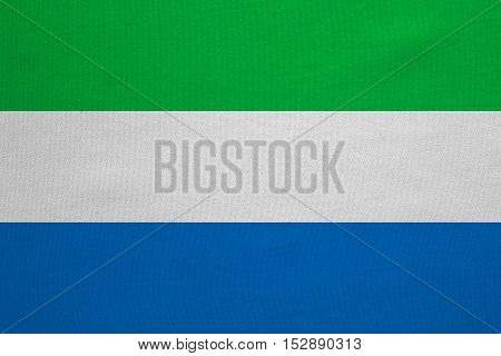 Sierra Leonean national official flag. African patriotic symbol banner element background. Correct colors. Flag of Sierra Leone with real detailed fabric texture accurate size illustration