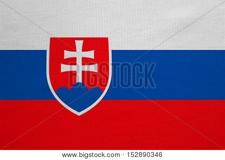 Slovakian national official flag. Patriotic symbol banner element background. Correct colors. Flag of Slovakia with real detailed fabric texture accurate size illustration