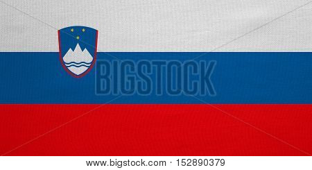 Slovenian national official flag. Patriotic symbol banner element background. Correct colors. Flag of Slovenia with real detailed fabric texture accurate size illustration