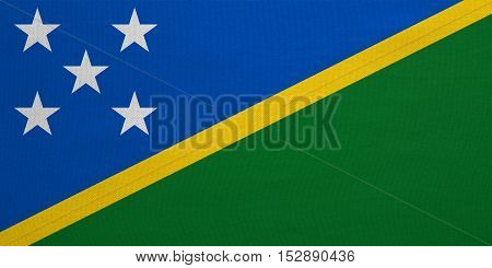 Solomon Island national official flag. Patriotic symbol banner element background. Correct colors. Flag of Solomon Islands with real detailed fabric texture accurate size illustration