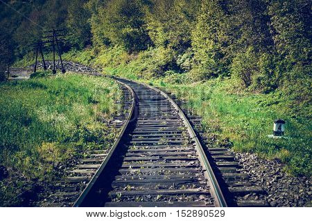 Rail goods path in the mountains on a background of mountain slopes and forest, Carpathians, Ukraine