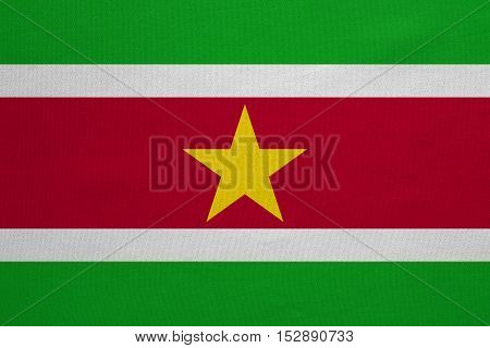 Surinamese national official flag. Patriotic symbol banner element background. Correct colors. Flag of Suriname with real detailed fabric texture accurate size illustration