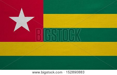 Togolese national official flag. African patriotic symbol banner element background. Correct colors. Flag of Togo with real detailed fabric texture accurate size illustration