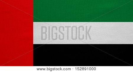 UAE national official flag. Patriotic symbol banner element background. Correct colors. Flag of the United Arab Emirates with real detailed fabric texture accurate size illustration