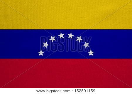 Venezuelan national official flag. Bolivarian Republic of Venezuela patriotic symbol banner element background. Correct color. Flag of Venezuela with real fabric texture accurate size illustration