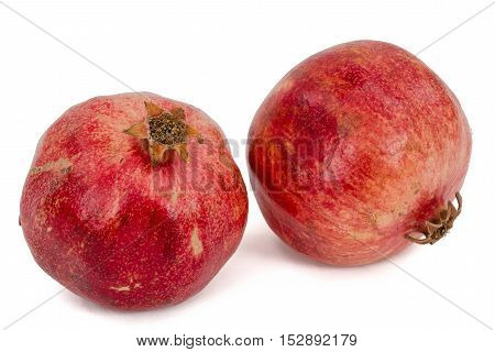 Two ripe pomegranate isolated on white background