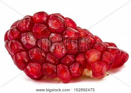 Ripe pomegranate seeds isolated on white background