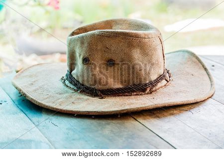 American West rodeo cowboy felt hat and authentic leather western riding boots with vintage ranching gear