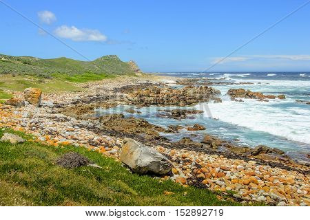 Pebble beach in the spectacular landscape of Cape of Good Hope Nature Reserve, Cape Peninsula National Park, South Africa.