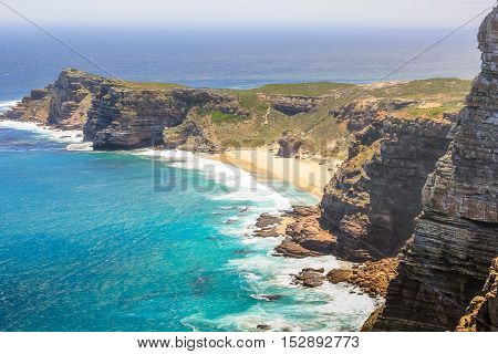 Aerial view of Cape of Good Hope and Dias Beach from lookout of Cape Point. Cape Point is a promontory at the southeast corner of the Cape Peninsula and is part of Table Mountain National Park.